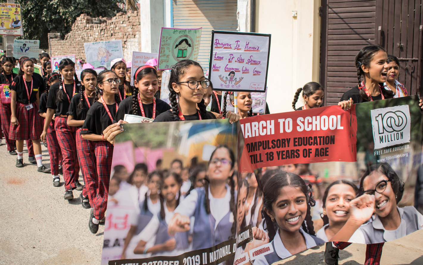 Grils March to School