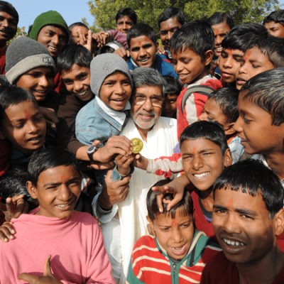 Mr. Kailash Satyarthi hold Nobel Medal with Bal Ashram children